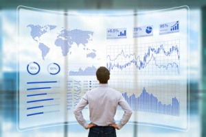 Business Person analysiert Big Data auf einem modernen Display